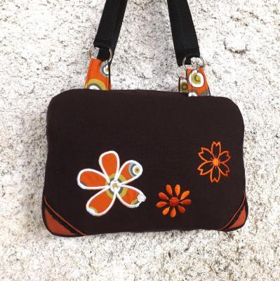 Sac valisette Noxy chocolat et fleurs oranges